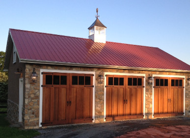 Hand made swing out carriage doors preserve historic character of carriage house