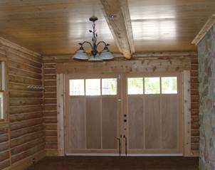 carriage doors allow an unobstructed ceiling space
