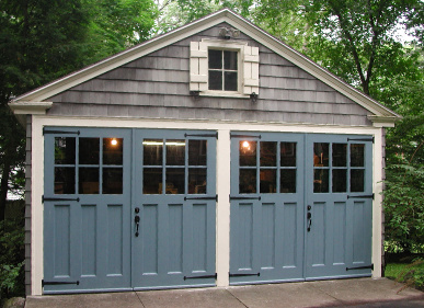 Custom made swing out carriage doors enhance the character of this carriage house