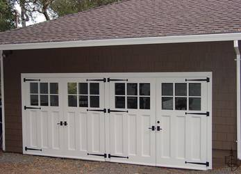 Oympic 6 lite carriage door transforms a typical rambler style home.