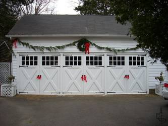 Olympic style 8 lite doors restore this 100 year old carriage house.
