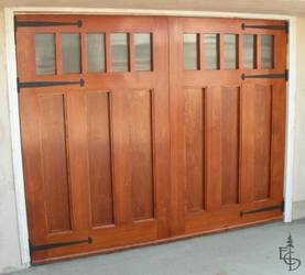 Carriage doors with flat panels and reeded glass have a contemporary but classic look.