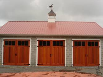 Carriage doors and a weather vane create a new classic carriage house.