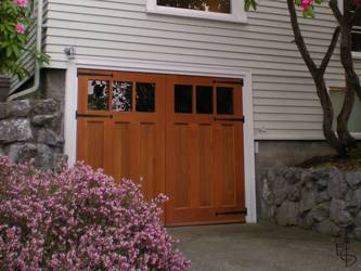 Carriage doors give this walk-out basement garage a whole new look.