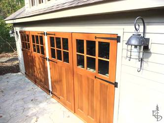 Carriage doors on detached carriage house.