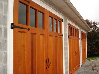 Three sets of carriage doors turn an ordinary block building into a showpiece.