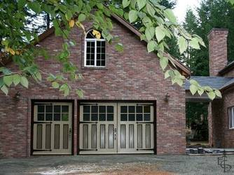 Brick carriage house with a custom 3-door set of OL8L doors with 4 panels.