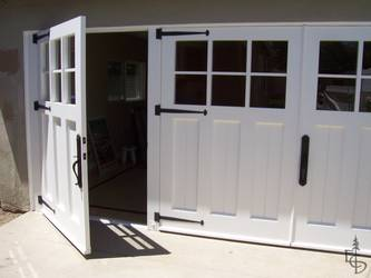 3 carriage doors enclose a newly remodeled studio exercise room turning an unused garage into new living space.