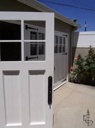 close up view of a 3 door set of Olympic style carriage garage doors