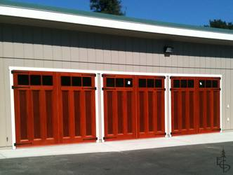 3 sets of carriage doors add increased light and functionality to this workshop