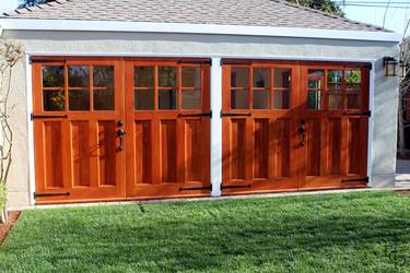 New carriage house with Olympic 6 lite craftsman style carriage garage doors